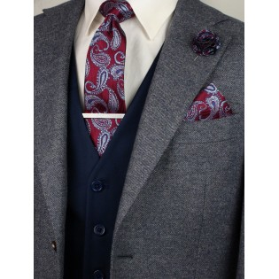 Matching burgundy paisley necktie and pocket square